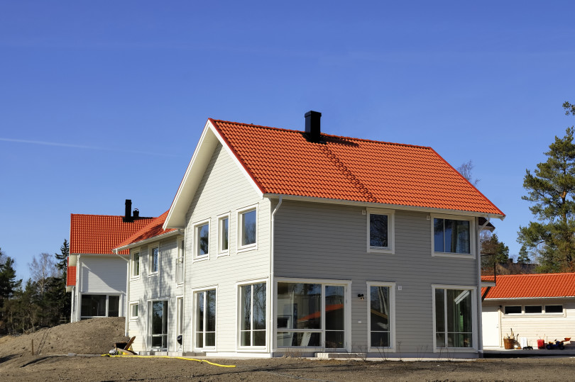 Swedish midde class house against blue sky.